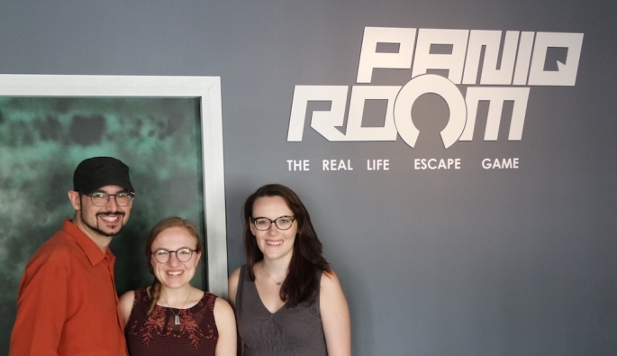 Team victory photo at Paniq Room. Features David, Lisa, and Devin from left to right.