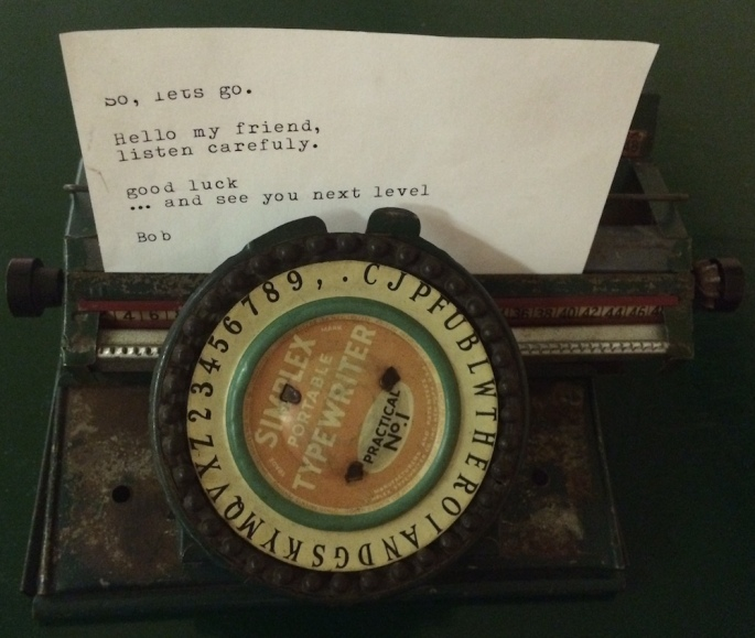 "An old portable typewriter with a typed letter in it. It reads, ""So, let's go. Hello my friend, listen carefuly. good luck ... and see you next level Bob"""