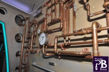 In-game image of the Rubicon. A series of copper tubing with a pressure gage.