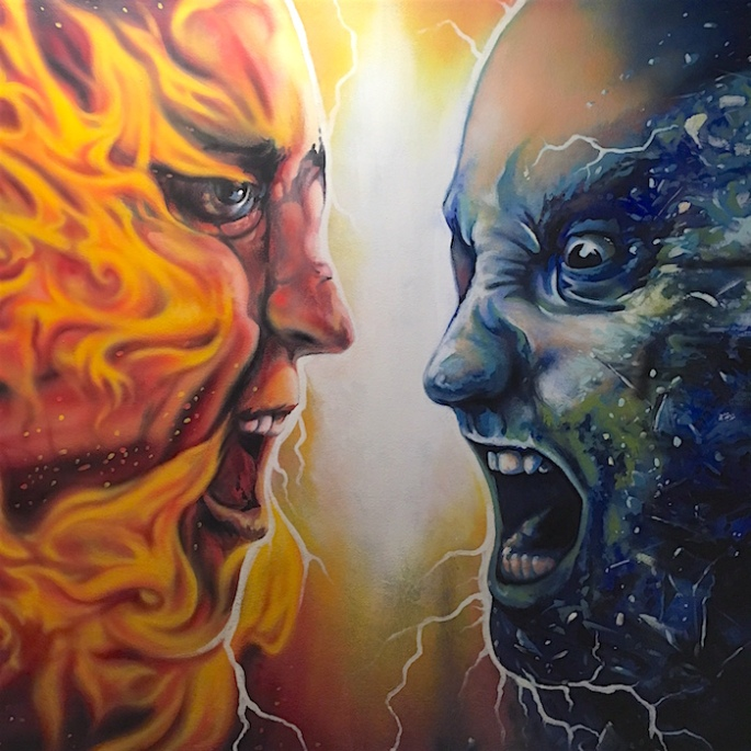 Two head-to-head faces. The red one is on fire. The blue one is radiating electricity.