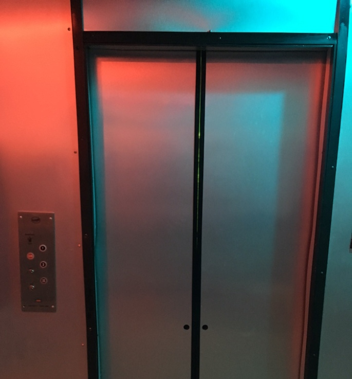 In-game, an elevator door.