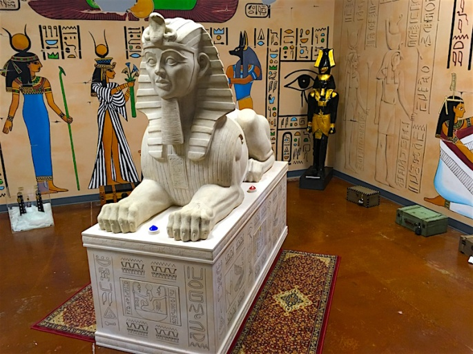 In-game, the walls are painted in hieroglyphics, small locked boxes lay about, and a massive sphinx statue sits in the middle of the room.