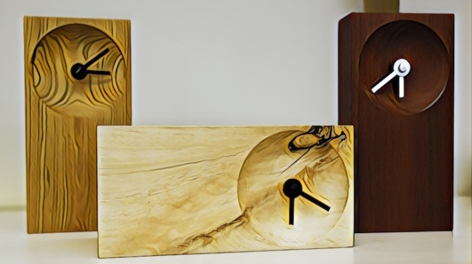 Stylized image of three beautifully handcrafted, minimalistic wood clocks.